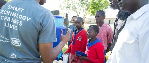 LifeStraw distribution team member Dan Olubero talks to prefects who will look after the LifeStraw Community filters at Visionary Academy