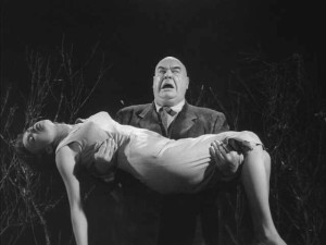 Tor Johnson as a zombie with his victim in cult movie Plan 9 from Outer Space (1959)