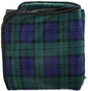 picnic blanket packed for traveling in the boot