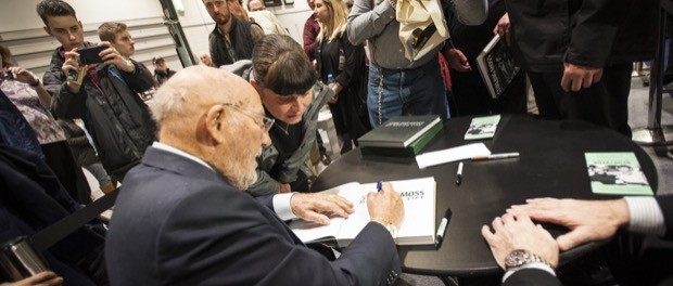 Stirling Moss signing books