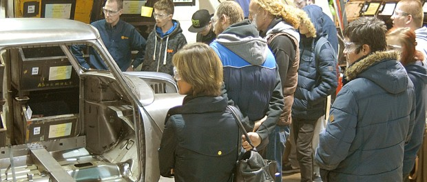 TRAX students look-on as a replacement classic Mini bodyshell takes place 2