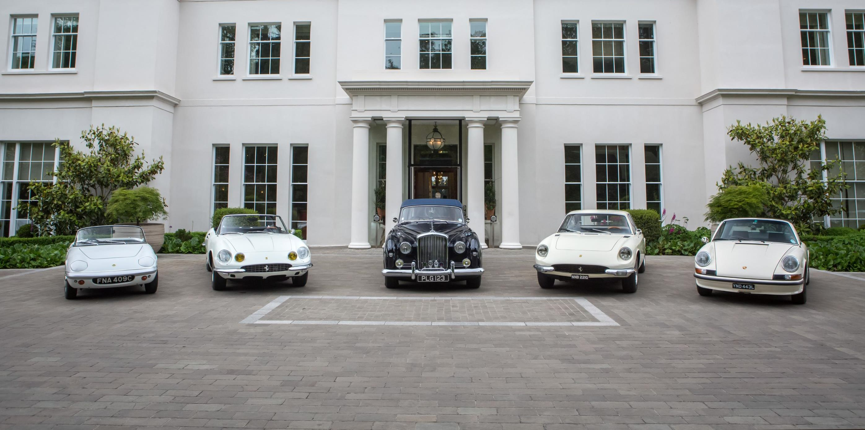 Members of the Concours of Elegance Committee at Coworth Park in Ascot, UK