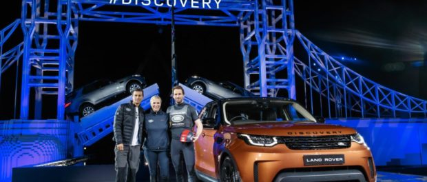 Bear Grylls, Zara Phillips and Sir Ben Ainslie pose by the new Land Rover Discovery in front of a world record-breaking LEGO Tower Bridge structure