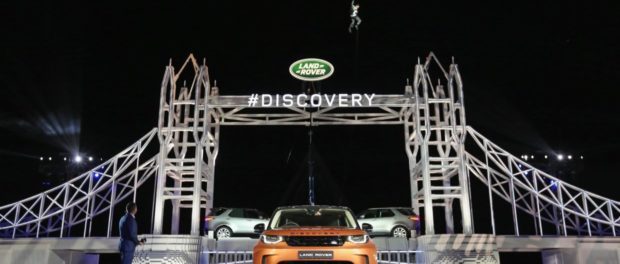 Bear Grylls rapels from a helicopter as he arrives at the global unveiling of the new Land Rover Discovery at Packington Hall, Solihull, UK