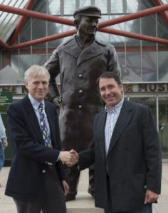 Lord Montagu and Jools Holland unveil statue