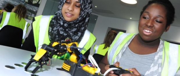 Female students learn about robot programming and control during visit to Solihull Avanced Manufacturing plant
