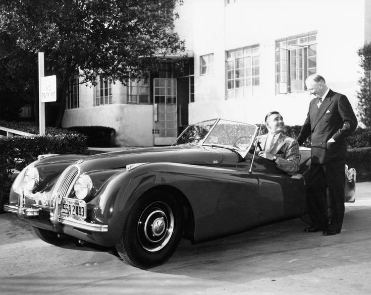 Sir William Lyons personally delivering an XK120 to Clark Gable