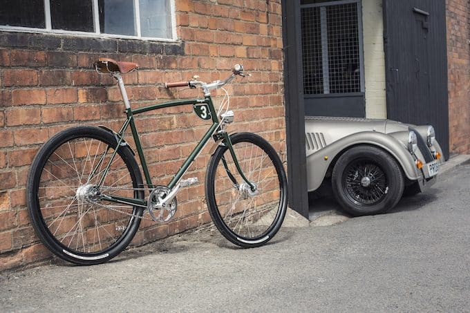 green Pashley bike with Morgan car