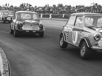 Minis racing at Silverstone in the sixties
