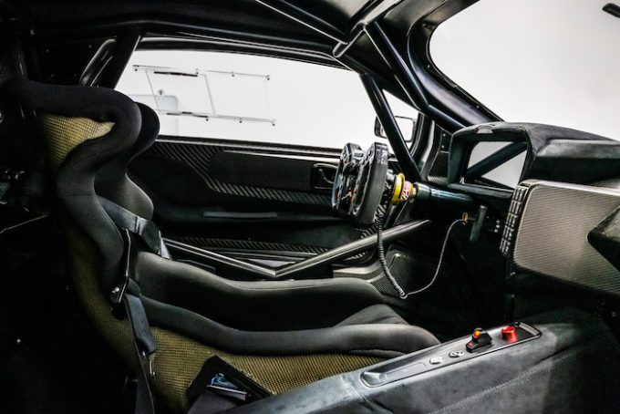Brabham BT62 interior with telematic control carbon fibre steering wheel.