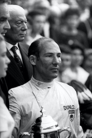 Stirling Moss taking the prize at Monaco