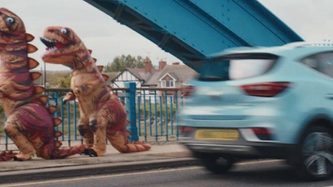 MG Pokes Fun At Dinosaur Drivers In New Electric Range TV Advert 1