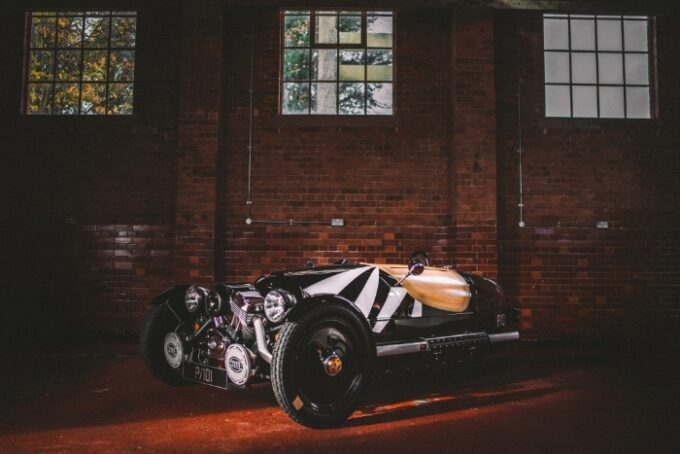 LIMITED-EDITION 3 WHEELER P101 - side shot agains brick wall