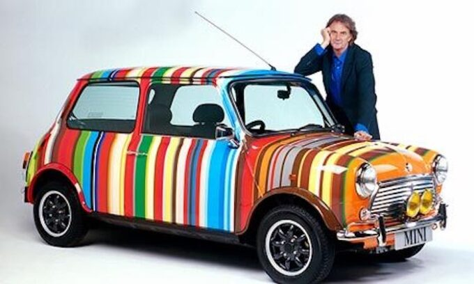 Sir Paul Smith with his design on a classic Mini