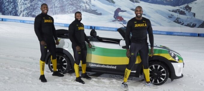 Jamaican Bobsled team get creative during lockdown with a MINI Convertible - Team beside MINI Cooper convertible.jpg