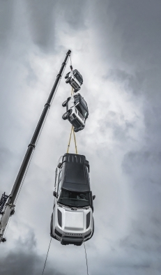Land Rover Defender is Top Gear's Car of the Year - Defender Dangling from a Crane
