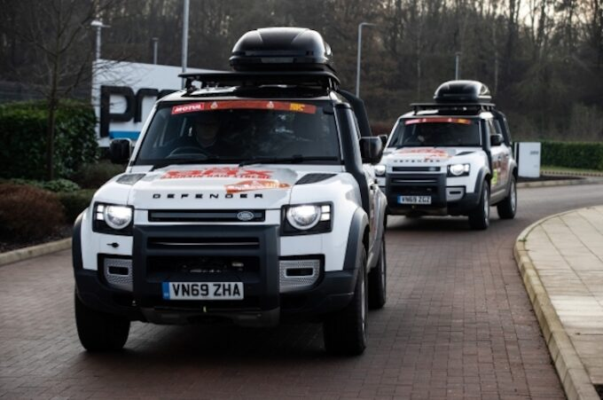 New Defender set to play vital role as Land Rover returns to the Dakar in 2021 - Pair of Defenders on road in full kit