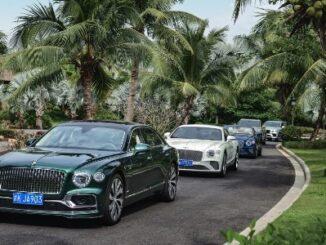 Bentley parade under palm trees