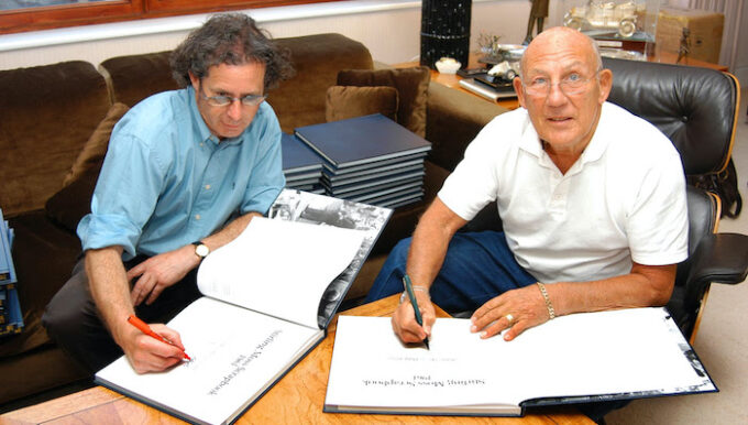 Philip Porter with Sir Stirling Moss signing copies of the Stirling Moss Scrapbook for Porter Press International