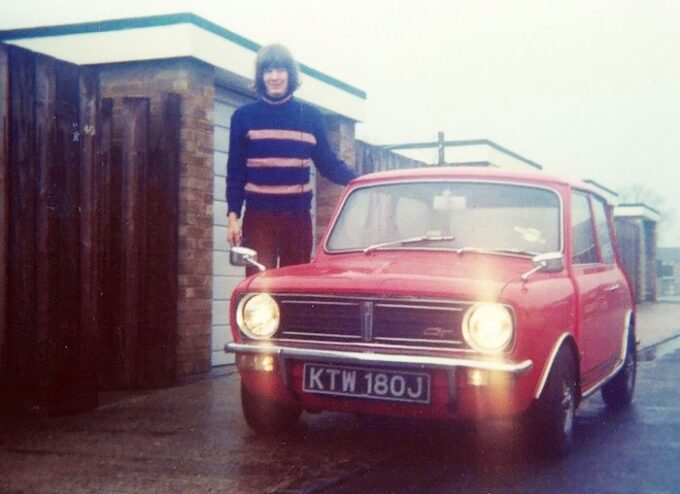 Graham Payne as a proud teenager posing with his own Mini 1275 GT