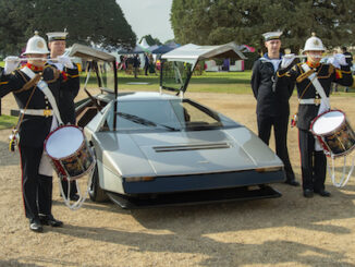 Royal Navy apprentices and Royal Marine Bandsmen welcome the car to Hampton Court
